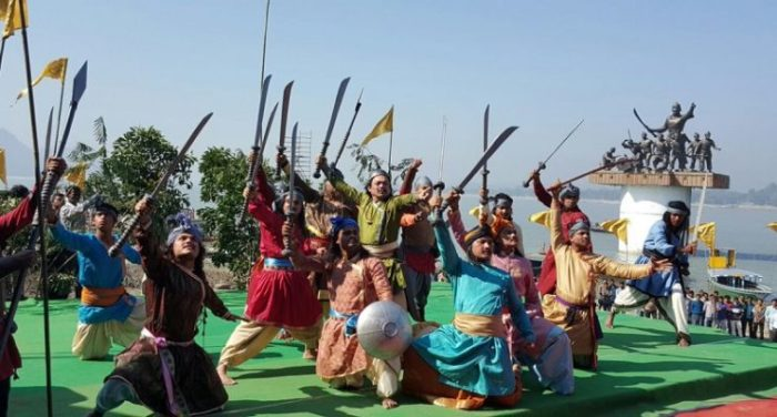 Local people in Assam performing Martial Arts beside the statue of Lachit Borphukan